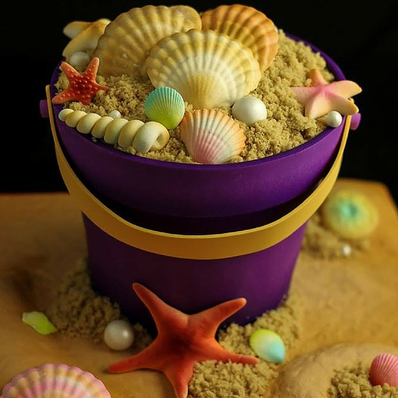 Beach sand and seashells in a bucket cake