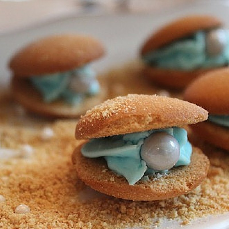Simple buttercream filled seashell biscuits with sugar pearl inside