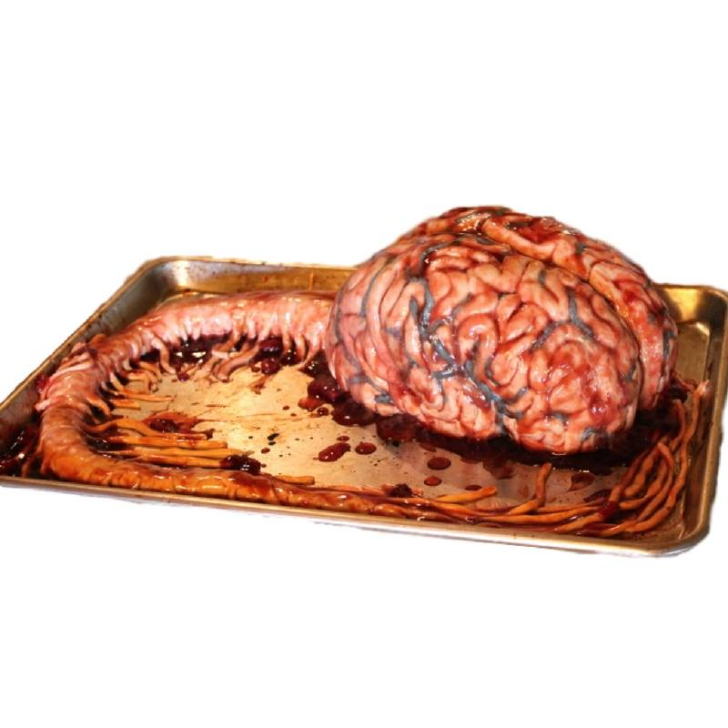 A very realistic brain cake on a medical tray