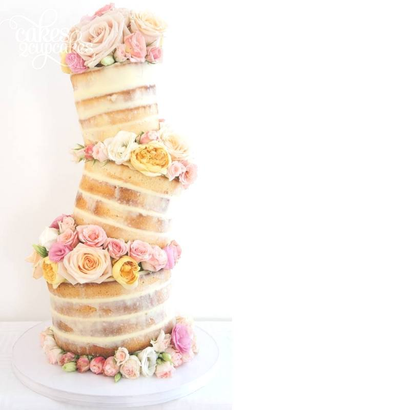 Topsy turvy naked cake decorated with cut roses
